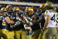 Philadelphia, PA - December 14, 2019:     Navy Midshipmen fullback Jamale Carothers (34) celebrates after scoring a touchdown during the 120th game between Army vs Navy at Lincoln Financial Field in Philadelphia, PA. (Photo by Elliott Brown/Media Images International)