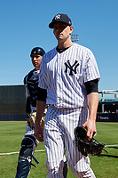 New York Yankees starting pitcher James Paxton (65) walks to the dugout from the bullpen with catcher Kyle Higashioka (66) before a Grapefruit League Spring Training game against the Toronto Blue Jays on February 25, 2019 at George M. Steinbrenner Field in Tampa, Florida.  Yankees defeated the Blue Jays 3-0.  (Mike Janes/Four Seam Images)