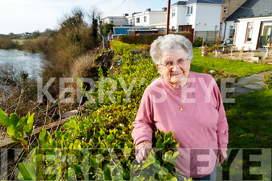 Ena Bunyan pictured at her home in Listowel showing the collapse of a bank of the River Feale.