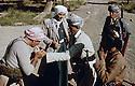 Iraq 1963 .Near Rawanduz, peshmergas sharing cigarets.Irak 1963.Peshmergas s'echangeant des cigarettes pres de Rawanduz