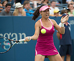 Jie Zheng (CHN) warms up then sits in the rain  in her match against Venus Williams (USA)at the US Open being played at USTA Billie Jean King National Tennis Center in Flushing, NY on August 28, 2013