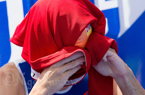 24 JUN 2012 - KITZBUEHEL, AUT - Aaron Harris  (GBR) of Great Britain tries to keep cool by covering his head with a T-shirt before the start of the elite men's 2012 World Triathlon Series round in Schwarzsee, Kitzbuehel, Austria (PHOTO (C) 2012 NIGEL FARROW)