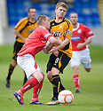Brechin's Andy Jackson gets a sore nose as he collides with Alloa's Ryan McCord ...