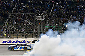 Monster Energy NASCAR Cup Series<br /> Go Bowling 400<br /> Kansas Speedway, Kansas City, KS USA<br /> Saturday 13 May 2017<br /> Martin Truex Jr, Furniture Row Racing, Auto-Owners Insurance Toyota Camry celebrates his win with a burnout<br /> World Copyright: Nigel Kinrade<br /> LAT Images<br /> ref: Digital Image 17KAN1nk10409