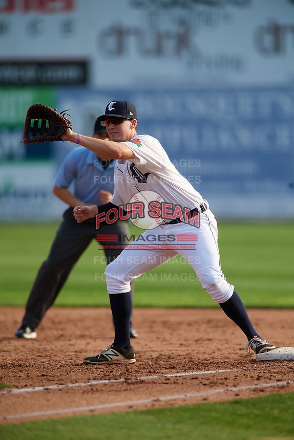 Connecticut Tigers first baseman Jordan Verdon (27) waits to receive a throw in front of first base umpire Edwin Jimenez during a game against the Lowell Spinners on August 26, 2018 at Dodd Stadium in Norwich, Connecticut.  Connecticut defeated Lowell 11-3.  (Mike Janes/Four Seam Images)
