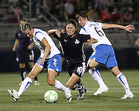 Homare Sawa #10 of the Washington Freedom is caught between Heather Mitts #2 and Amy LePelbet #6 of the Boston Breakers during a WPS match at Maryland Soccerplex on July 29, in Boyds, Maryland. Freedom won 1-0.