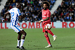 CD Leganes's Allan Romeo Nyom and Real Madrid's Marcelo Vieira during La Liga match between CD Leganes and Real Madrid at Butarque Stadium in Leganes, Spain. April 15, 2019. (ALTERPHOTOS/A. Perez Meca)