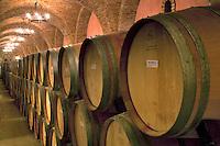 Wine aging in barrels in cellar. Castello di Amorosa. Napa Valley, California. Property relased