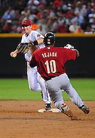 Apr. 30, 2008; Phoenix, AZ, USA; Arizona Diamondbacks shortstop Stephen Drew forces out a sliding Houston Astros base runner (10) Miguel Tejada in the second inning at Chase Field. Mandatory Credit: Mark J. Rebilas-