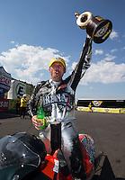 Jul. 21, 2013; Morrison, CO, USA: NHRA pro stock motorcycle rider Shawn Gann celebrates after winning the Mile High Nationals at Bandimere Speedway. Mandatory Credit: Mark J. Rebilas-