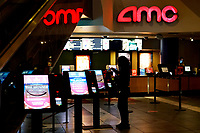 NEW YORK, NEW YORK - MARCH 05: A woman cleans a ticket machine at AMC Cinema in Times Square on March 05, 2021, in New York. NY Governor, Andrew Cuomo gave the permission to reopen cinemas on Feb. 22 at 25% capacity, or a maximum of 50 people per show. (Photo by John Smith/VIEWpress)