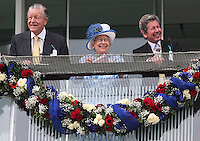 Britain's Queen Elizabeth watches from the balcony with Sir Michael Oswald (L) and the Queen's Bloodstock and Racing Advisor John Warren (R) <br /> Ippica Investec Derby meeting taking place at Epsom Downs Racecourse -  06/04/2016 <br /> Foto Matthew Childs / Action Images / Panoramic