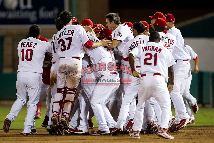 Members of the Springfield Cardinals celebrate after Ryan Jackson (23) of the Springfield Cardinals hit the game winning base hit during a game against the Midland RockHounds at Hammons Field on July 11, 2011 in Springfield, Missouri. (David Welker / Four Seam Images)