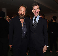 """NEW YORK CITY - OCTOBER 4: Peter Sarsgaard and Craig Erwich, President, Hulu & ABC Entertainment attend the red carpet premiere of Hulu's """"DOPESICK"""" at the Museum of Modern Art on October 4, 2021 in New York City. . (Photo by Frank Micelotta/Hulu/PictureGroup)"""
