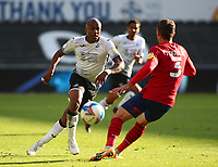 17th October 2020; Liberty Stadium, Swansea, Glamorgan, Wales; English Football League Championship Football, Swansea City versus Huddersfield Town; Andre Ayew of Swansea City plays the ball around Harry Toffolo of Huddersfield Town as Swansea City attack in the first half