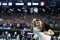 LAS VEGAS, NV - AUGUST 1: Paul Arriola #7 Donovan Pines of the United States celebrates during a game between Mexico and USMNT at Allegiant Stadium on August 1, 2021 in Las Vegas, Nevada.