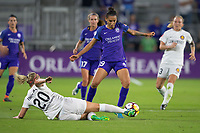Orlando, FL - Saturday March 24, 2018: Orlando Pride defender Poliana Barbosa Medeiros (19) is tackled by Utah Royals forward Elise Thorsnes (20) during a regular season National Women's Soccer League (NWSL) match between the Orlando Pride and the Utah Royals FC at Orlando City Stadium. The game ended in a 1-1 draw.