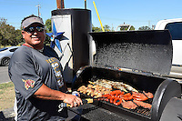John Flores of Bulverde, Texas cooks, chicken, sausage, stake and corn for his family and friends at a tailgate before NCAA Football game kickoff, Saturday, October 04, 2014 in San Marcos, Tex. (Mo Khursheed/TFV Media via AP Images)