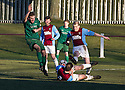 The ball strikes the arm of Whitehill's Ryan McKenzie as he lies on the ground and Referee Barry Reid awards the penalty.