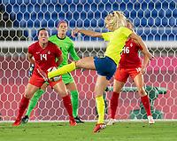 YOKOHAMA, JAPAN - AUGUST 6: Sofia Jakobsson #10 of Sweden takes a shot during a game between Canada and Sweden at International Stadium Yokohama on August 6, 2021 in Yokohama, Japan.