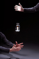 """CONVECTION: DROPPING JAR WITH LIT CANDLE (2 of 3)<br /> Convection & Flow of Oxygen Cease  in Freefall<br /> The candle-in-a-bottle is dropped.  In a freely falling frame of reference, objects behave as if there is no net gravity force, thus no """"up"""" for the hot air. The diminishing supply of oxygen causes the flame to dim."""