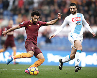 Roma's Mohamed Salah, left, is challenged by Napoli's Raul Albiol during the Italian Serie A football match between Roma and Napoli at Rome's Olympic stadium, 4 March 2017. <br /> UPDATE IMAGES PRESS/Isabella Bonotto