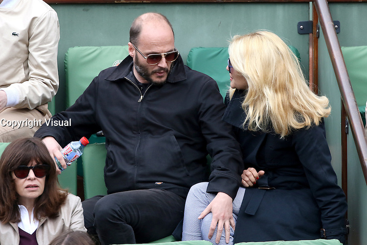 Fabrice Du Velz and Helena Noguerra watching tennis during Roland Garros tennis open 2016 on may 24 2016.