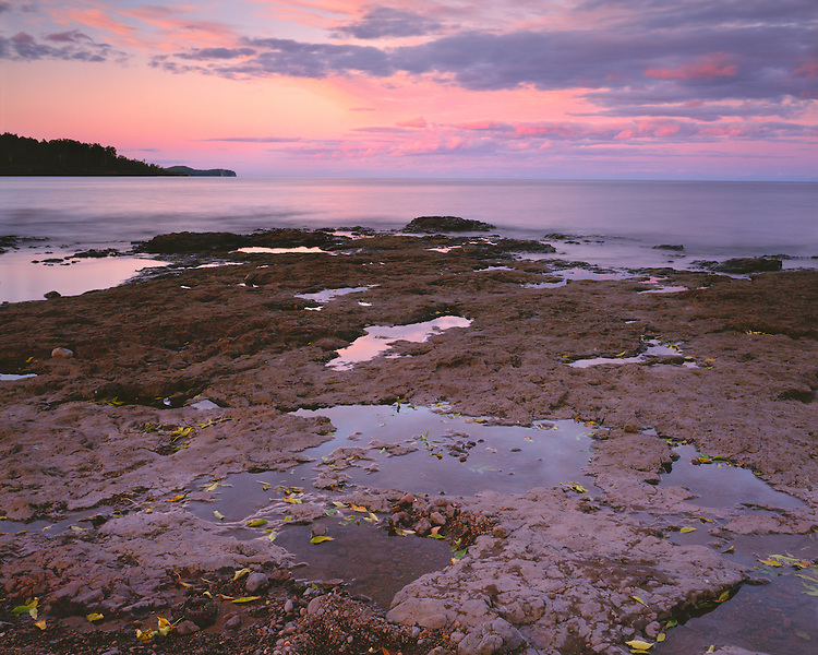 Sunset glow on the rocky shore of Lake Superior on the North Shore; Gooseberry Falls State Park, MN