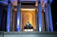 Mongolia, Ulaanbaatar. Sukhbaatar Square, statue of Genghis Khan at night.