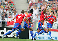 Ronald Gomez (11) of Costa Rica celebrates his goal with teammates. Poland defeated Costa Rica 2-1 in their FIFA World Cup Group A match at FIFA World Cup Stadium, Hanover, Germany, June 20, 2006.