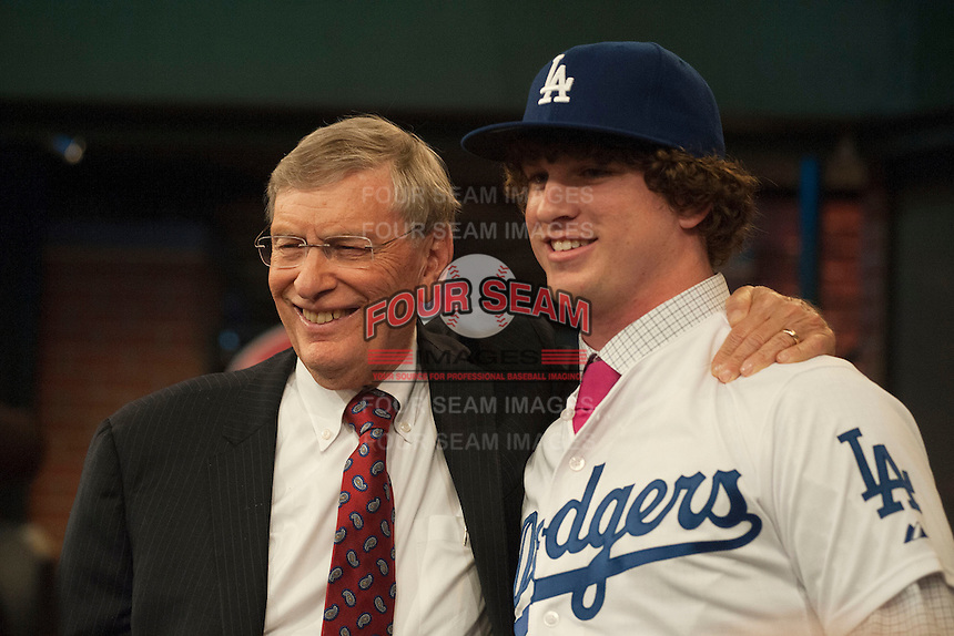 Pitcher Grant Holmes (Conway H.S. (SC)) the number 22 overall pick to the Los Angeles Dodgers with Commissioner Bud Selig during the MLB Draft on Thursday June 05,2014 at Studio 42 in Secaucus, NJ.   (Tomasso DeRosa/ Four Seam Images)