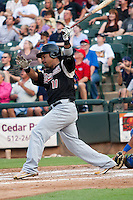 Sacramento River Cats designated hitter Manny Ramirez #11 swings during the Pacific Coast League baseball game against the Round Rock Express on May 24, 2012 at the Dell Diamond in Round Rock, Texas. The Express defeated the River Cats 5-3. (Andrew Woolley/Four Seam Images).