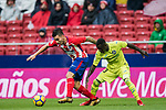Angel Correa (L) of Atletico de Madrid competes for the balding Amath Ndiaye Diedhiou of Getafe CF during the La Liga 2017-18 match between Atletico de Madrid and Getafe CF at Wanda Metropolitano on January 06 2018 in Madrid, Spain. Photo by Diego Gonzalez / Power Sport Images