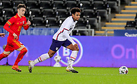 SWANSEA, WALES - NOVEMBER 12: Weston McKennie #8 of the United States chases down a ball during a game between Wales and USMNT at Liberty Stadium on November 12, 2020 in Swansea, Wales.