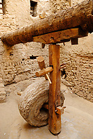 The wheat mill is located in the yard of a house and it was operated manually. The wheat was milled by a miller who worked for the village. Al Qasr is situated in the Dakhla oasis in the Lybian Desert in the West of Egypt. With a population of around 700, the town was built from Roman ruins and has narrow covered streets. There are 54 lintels, some dating from the Ottoman and Mamluk era which adorn the old houses, one of which dates to about 924 AD. The mosque dates back to the Ayyubid period with three-story-mud-brick, 21 meters high.