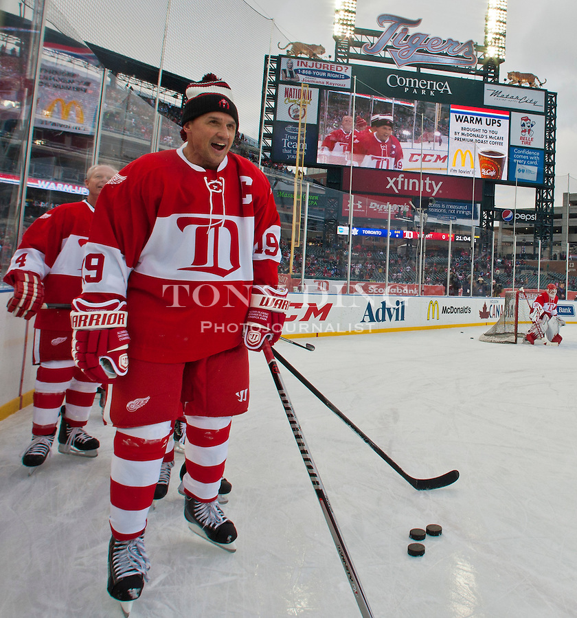 31 December 2013: Former Detroit Red Wings forward Steve Yzerman (19) wait his turn to practice a play during warmups before the Toronto Maple Leafs v Detroit Red Wings Alumni Showdown hockey game, at Comerica Park, in Detroit, MI.