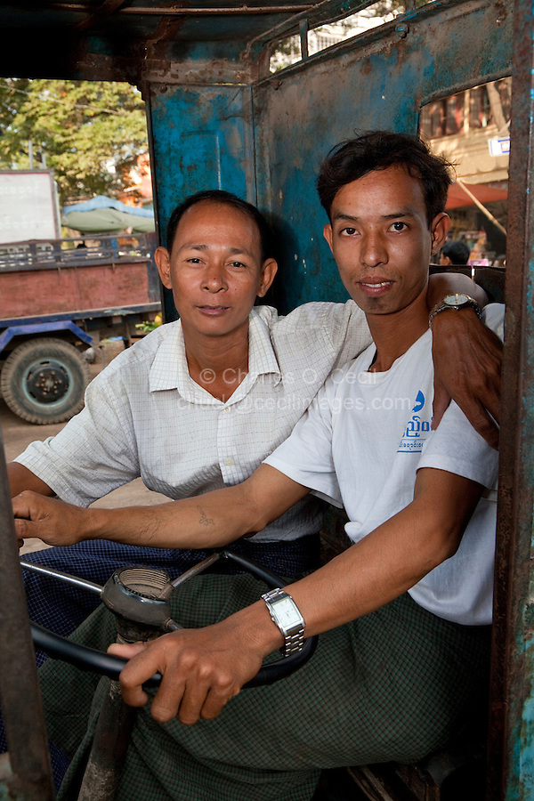 Myanmar, Burma, Mandalay.  Two Men in a Motorickshaw.