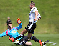 Pictured: Lee Trundle (R) fails to score against Jez McCluskey Thursday 21 May 2015<br />