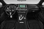 Stock photo of straight dashboard view of 2016 BMW M6 Convertible - 2 Door Convertible Dashboard