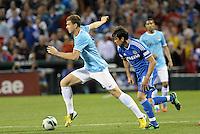 Edin Dzeko (10) Manchester City drives at the Chelsea defence..Manchester City defeated Chelsea 4-3 in an international friendly at Busch Stadium, St Louis, Missouri.