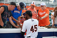 Aberdeen IronBirds Leonardo Rodriguez (45) signs autographs before a NY-Penn League game against the Vermont Lake Monsters on August 19, 2019 at Leidos Field at Ripken Stadium in Aberdeen, Maryland.  Aberdeen defeated Vermont 6-2.  (Mike Janes/Four Seam Images)