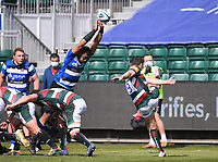 18th April 2021 2021; Recreation Ground, Bath, Somerset, England; English Premiership Rugby, Bath versus Leicester Tigers; Ben Youngs of Leicester Tigers kicks under pressure from Taulupe Faletau of Bath