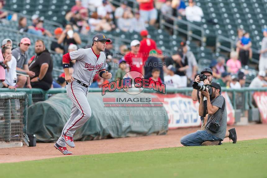 AFL East infielder Carter Kieboom (24), of the Salt River Rafters and the Washington Nationals organization, jogs onto the field during player introductions before the Arizona Fall League Fall Stars game at Surprise Stadium on November 3, 2018 in Surprise, Arizona. The AFL West defeated the AFL East 7-6 . (Zachary Lucy/Four Seam Images)