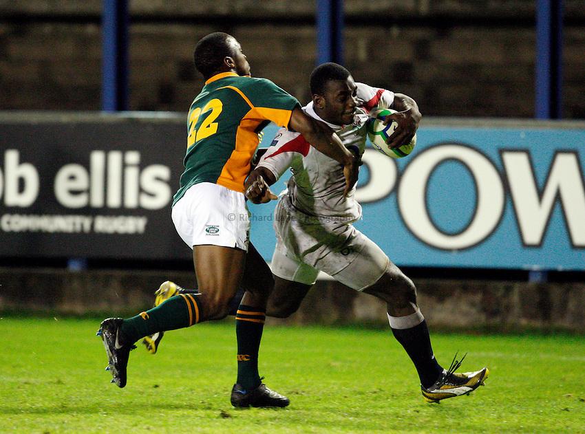 Photo: Richard Lane/Richard Lane Photography. England U20 v South Africa U20. Semi Final. 18/06/2008. England's Miles Benjamin is tackled by South Africa's Vainon Willis.