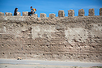 Essaouira, Morocco.  Tourists Rest atop Town  Ramparts facing the Sea.