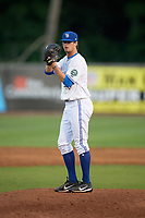 Bluefield Blue Jays relief pitcher Troy Watson (14) looks in for the sign during a game against the Bristol Pirates on July 26, 2018 at Bowen Field in Bluefield, Virginia.  Bristol defeated Bluefield 7-6.  (Mike Janes/Four Seam Images)