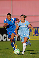 Kacey White (20) of Sky Blue FC is chased by Angela Hucles (16) of the Boston Breakers. Sky Blue FC defeated the Boston Breakers 2-1 during a Women's Professional Soccer match at Yurcak Field in Piscataway, NJ, on May 31, 2009.
