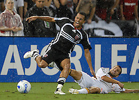 DC United midfielder Fred (7) gets fouled by Los Angeles Galaxy midfielder Kyle Martino (18). DC United defeated the Los Angeles Galaxy 1-0 at RFK Stadium in Washington DC, Thursday August 9, 2007.