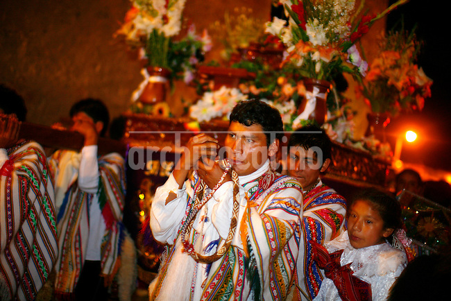 Men carry a cross during a celebration of Corpus Christi in Ollantaytambo, Peru, on May 17, 2008. Corpus Christi is the result of the syncretism between Catholic and indigenous faiths, for the Incas carried the mummified remains of their sovereigns in procession at the same time of year as the Catholic celebration of Corpus.