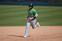 Orlando Arcia (13) of the Gwinnett Stripers rounds the bases after hitting a home run during the game against the Charlotte Knights at Truist Field on May 9, 2021 in Charlotte, North Carolina. (Brian Westerholt/Four Seam Images)